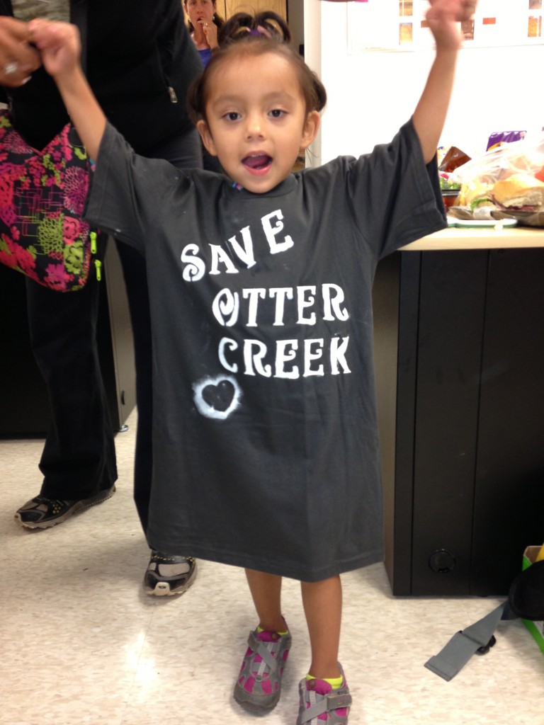 Aspen shows off her new Save Otter Creek t-shirt. August 2013.