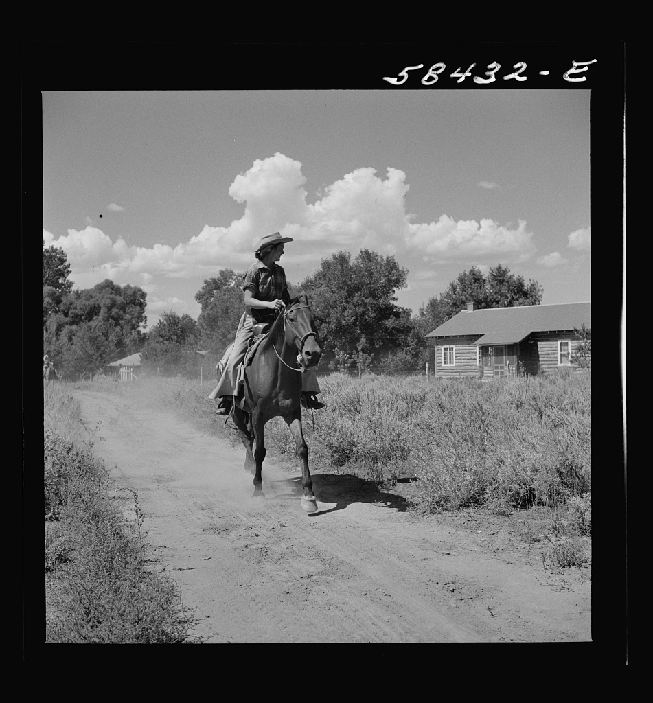 Dude returning from a morning ride. Quarter Circle U Ranch, Birney, Montana 1941 Aug.  Wolcott, Marion