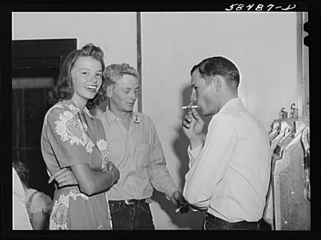 Dude girl with two cowboys at a Saturday night dance in Birney, Montana1941 Aug.  Wolcott, Marion Post, 1910-1990,